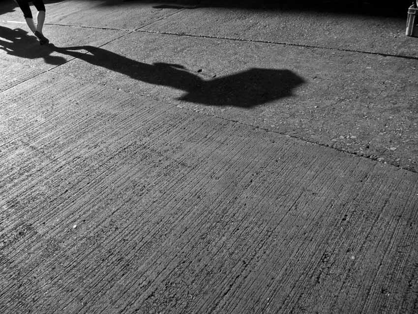 shadow-umbrella-street-photography-hongkong-minimalist-blackandwhite